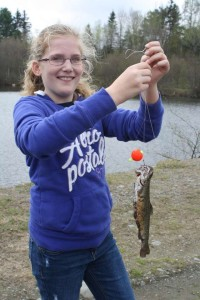 "Hannah caught her fish just as it was announced ""time to leave."""
